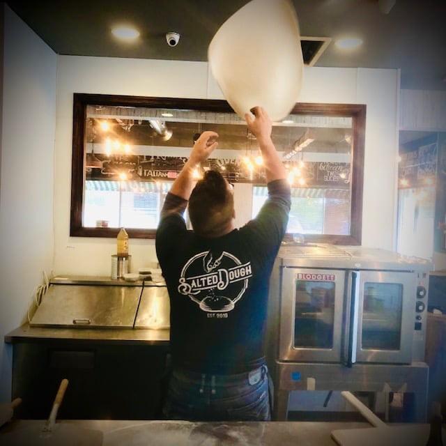 Chef Jeff preparing pizza
